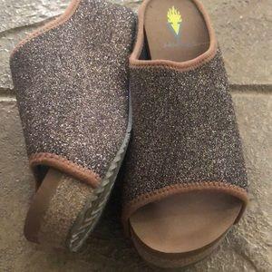 Volatile slip on sandals